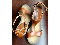 Tan wedge size 4 sandal with buckle fastener