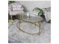 Melody Maison - Large Gold Oval Glass Topped Coffee Table. RRP £399.99