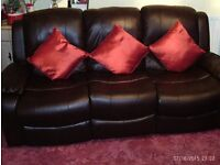 LOVELY DARK BROWN LEATHER 3 SEATER SOFA AND 2 CHAIRS ALL RECLINING VERY GOOD CONDITION 2 YEARS OLD.