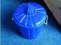Blue plastic bin with handles which grip the lid on