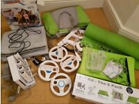 Nintendo Wii, 4 contollers & docking station. Wii Fit & Balance Board & bag, Mario Kart & 4 Wheels