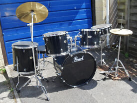 8-piece drum kit pre-owned in good condition
