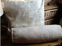 2 cream cushions