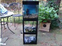 Fish tank / aquarium - Askoll - on cabinet with loads of accessories