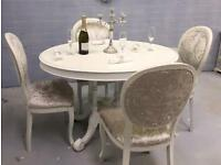 Round white dining table with u usual carved base and 4 crushed silver chairs