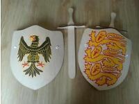 Two wooden children's play swords amd shields