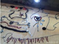 10 items of red/black goth style jewellery