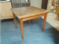 Extending solid oak dining table