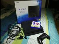 Playstation 4 1TB like new no scratches + Fifa 15