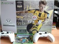 xbox one 1TB+2 controllers+minecraft+fifa17(built in). Hardly used(*5) as new boxed.