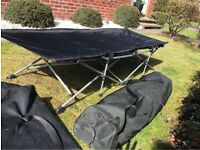 Folding camp beds in carry bags