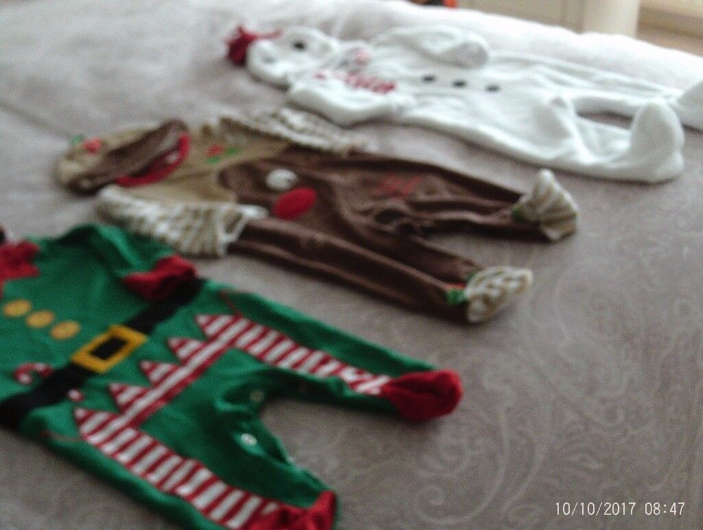 Three Christmas all in one outfits with hats aged 3-6 months