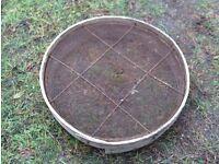 Vintage garden sieve with wooden surround