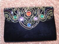 black velvet hand bag