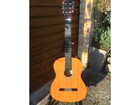 Guitar - Acoustic Hohner handcrafted with stand and guide book