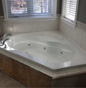 Corner tub with jets and faucets