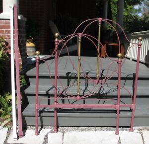 Twin sized antique brass and iron bed