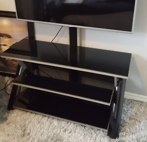 """For Sale Reilan TELEVISION STAND suitable for up to 55""""-67"""" tv."""