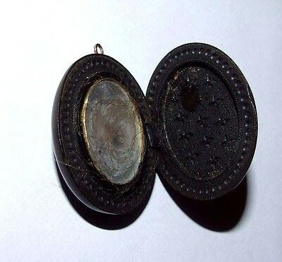 ANTIQUE VICTORIAN VULCANITE MOURNING OR LOVE LOCKET PENDANT.