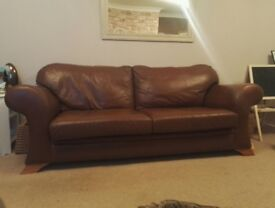 Two and three seater brown leather sofas