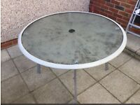 Silver metal Garden Table with Glass Top, in excellent condition!