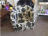 Black and cream floral tub chair