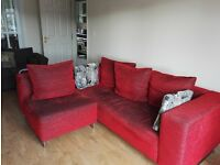 Open to offers on 4 seater red corner sofa with moveable corner available for immediate collection