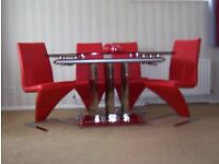 RED GLASS TOP EXTENDING TABLE AND FOUR CHAIRS