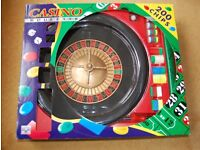 Roulette wheel and casino case of Texas hold-em and roulette chips and cards £35