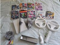 Nintendo Wii with one controller and 9 games