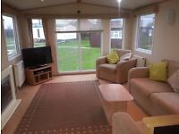 Large static caravan sited at parkdean resorts camber sands. Central heating and is double glazed
