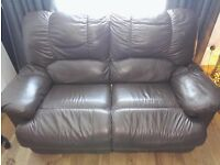 2 leather reclining sofas, manual recline