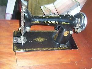 ANTIQUE  SINGER MACHINE IN SOLID WOOD CABINET