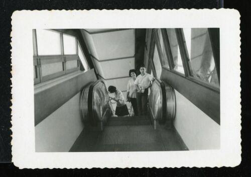 Vintage Photo PUERTO RICAN FAMILY RIDES ESCALATOR AT HONG KONG AIRPORT? 1960