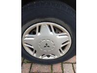 "Set of four Mitsubishi hubcaps, for R13 (13"") wheels. Hub cap wheel trims"