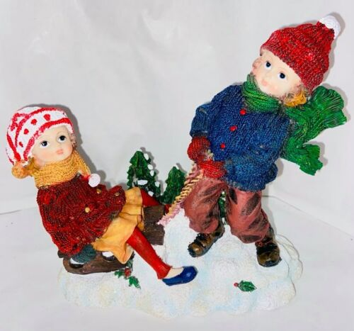 Girl+and+Boy+On+Sledge+In+Snow+Christmas+Decorative+Ornament+16+x+17cm