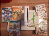 Nintendo Wii with two controllers, Wii Fit and games