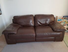 2 Seater Brown leather sofa from smoke and pet free house. Good condition