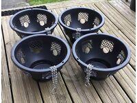 Four black hanging baskets