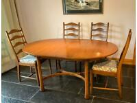 Ercol Windsor extending dining table & four chairs