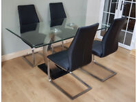 Clear Glass Dining Table And 4 Grey Faux Leather Chairs