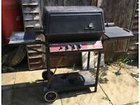 STERLING/OMC 2522 Gas BBQ with Ceramic Briquets and Gas Cylinder.