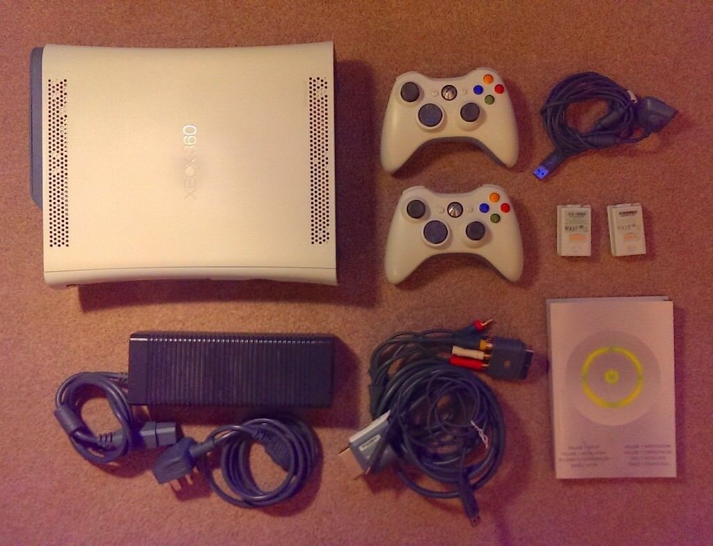 Xbox 360 with 2 controllers and charging packs + Included Games