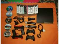 PS3 + move accessories + controllers + 27 games