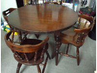 £200 ONO - Vintage - Solid dark oak round country style dining table and four chairs.