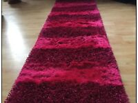 Brand new hall way rug in pink