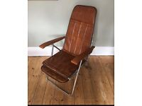 1970's folding faux leather chair with pull out foot rest