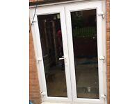 White UPVC patio doors, frame and keys