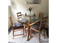 Glass and oak dining table