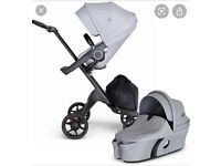 Stokke explory V6 pram buggy with seat and carrycot, plus accessories